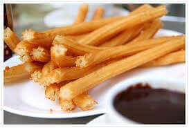 Churros and chocolate dip, the traditional Spanish and Portuguese treat.