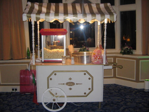 An image showing a combined candy floss and popcorn cart available for hire