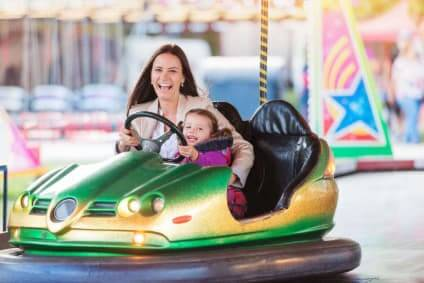 Mother And Child On Dodgems Ride