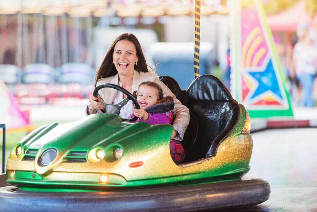 Mam And Child Having Fun On The Dodgems