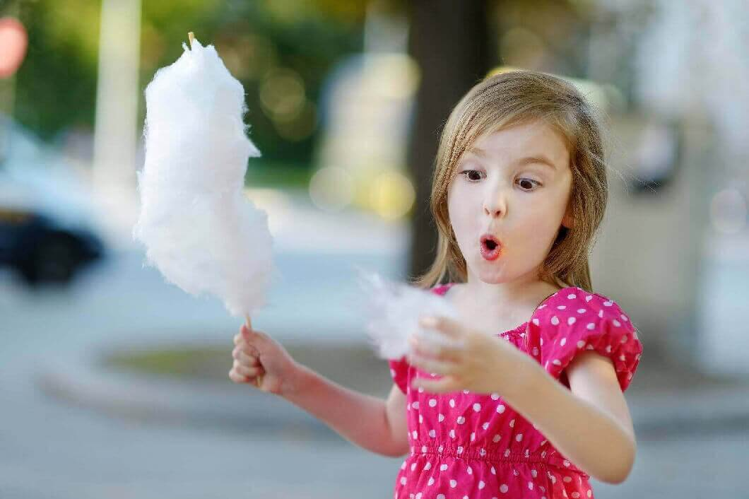 Young Girl Eating CandyFloss